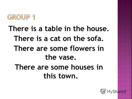 There is a table in the house. There is a cat on the sofa. There are some flowers in the vase. There are some houses in this town.